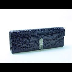 Navy Faux Croc Clutch This awesome clutch feathers a silver rhinestone embellished snap closure, fully lined, detachable silver shoulder strap, and interior slip pocket. Measures: 10.5 W X 4 H X 2D ( This closet does not trade or use PayPal ) Bags Clutches & Wristlets