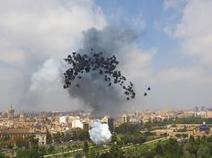 Cai Guo-Qiang (b. 1957). Black Rainbow: Explosion Project for Valencia, 2005. Realized at Old Turia Riverbed Park, between Royal Bridge and Trinidad Bridge, Valencia, May 22, 2005, 12:05 pm, approximately 1 minute. 1,400 3-inch black smoke shells. Commissioned by Insitut Valencia d'Art Modern for the exhibition Cai Guo-Qiang: On Black Fireworks