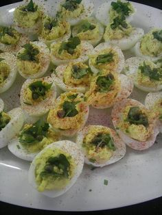 Wasabi deviled eggs with dandelion greens and capers.