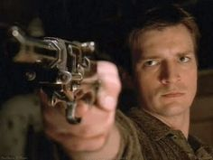 """Malcolm """"Mal"""" Reynolds (Nathan Fillion) in the 2002 TV series Firefly and the following movie Serenity"""