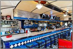 George & Sally's Roadside Diner, Hickory Corners, Michiganbymrkyle229  Awesome diner interior. Wow.  And BTW, about diners (from Wikipedia):    A diner is a prefabricated restaurant building characteristic of North America, especially on Long Island, in New York City, in New Jersey, and in other areas of the Northeastern United States, although examples can be found throughout the US and in Canada. Some people apply the term not only to the prefabricated structures, but also to restaurant