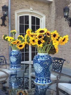 The Enchanted Home - Rediscover Your Home Love the sunflowers in the blue and white---possibly in one of my urns?