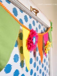 colorful canvas and burlap flower pennant - add DIY burlap flowers to canvas triangle bunting for the perfect touch in the home - great for studio, scrapbooking room, play room or little girls room - simple DIY!!!