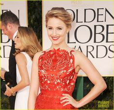 Diana Agron: beautiful soft swept back hair, gorgeous poppy red laser cut dress with matching lips (GG '12)
