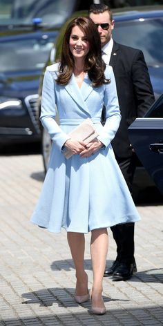 Middleton looked like a real-life princess on a royal visit to Luxembourg on Thursday in a baby blue coatdress by Emilia Wickstead that cinched at her waist and finished with an A-line skirt. She paired the coat with a nude clutch and matching pointed-toe pumps (shop a similar style here), accessorizing with drop earrings and her stunning engagement ring. from InStyle.com