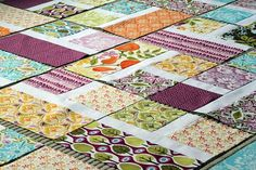 This is going to be my next quilt.  I love the colors, the layout....everything!  Looks like some summer fun for winter warmth!