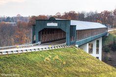 The Smolen–Gulf Bridge is a covered bridge across the Ashtabula River in…