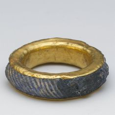 Gold ring inlaid with fluted lapis lazuli. Aigina treasure.