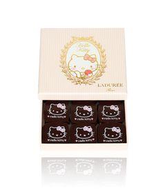 Hello Kitty x Ladurée chocolates. Ivory ganache with a Bourbon vanilla infusion & crunchy chocolate pearls.