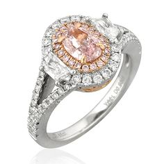 This pink oval ring by Yael Designs features trapezoid diamonds set in an 18k two-tone gold band with white and pink diamonds.