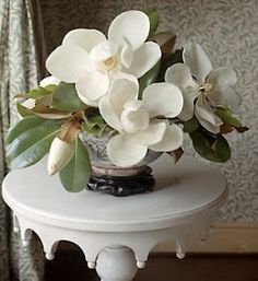 .Magnolias, Stunning. When doing a magnolia arrangemnt if you cut your own or purchase, make sure there are unopened buds, it will add interest to the arrangement.