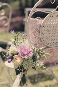 English Garden Ceremony Chairs with Twine Tied Bouquets down the Aisle.