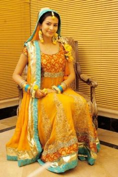 Yellow, green and orange is mostly being used on the mehndi dresses to go with the overall theme of the mehndi function. Some designers are using many different colors in mehndi dresses also.