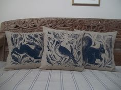Hand screen printed cushions.Bird,hare and squirrel designs from original lino cuts.