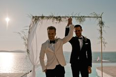 Two handsome grooms travel along with their closest friends and family all the way to their favorite holiday destination in Mykonos to exchange vows under the Aegean sky Play Hard To Get, Moving In Together, Everything Is Possible, Crystal Clear Water, First Dates, White Ribbon, Mykonos, Holiday Destinations, Favorite Holiday