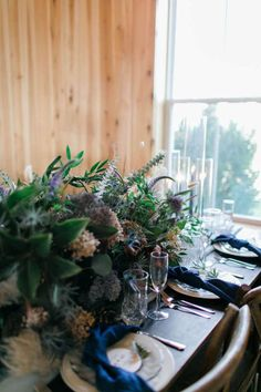 low centerpiece with green tones for long table