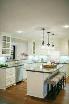 "A Pretty Kitchen Makeover from HGTV Fixer Upper - Silestone Quartz countertops with ""Chenille White"" limestone tile backsplash and a Tilebar Imperial Cumulus Clouc backsplash accent, pendant lights, farm sink"