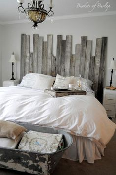 Interesting! Rustic headboard made from reclaimed barn wood. Connected at various heights for an added rustic element to a romantic farmhouse bedroom.