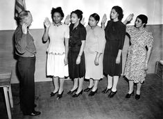 Lt. James L. Munson administers the oath of service to five American women who are sworn in as members of the Women's Auxiliary Army Corps (WAAC) at Grand Central Place in New York City on October 15th, 1942.