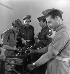 A class of recruits in the technical training wing of a Greek training centre are given advice from a British instructor during the civil war. (Photo by Keystone Features/Getty Images). 1947