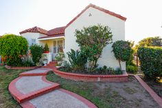 3 Bed | 1.5 Bath | 1190 sqft | Spanish charmer in Reynier Village. Spacious living room, with formal dining which feature hardwood floors.