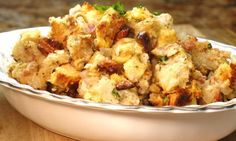"Print Pancetta and Fig Stuffing Ingredients:1 loaf french or sourdough bread, cut in 1/2-1"" cubes (about 9-10 cups) 3/4 cup chopped walnuts 1 stick butter 2 cloves garlic, smashed with flat edge of knife, then minced 2 cups yellow onion, diced medium sized 6 ounces Pancetta, chopped (bacon may be substituted) 1 teaspoon each fresh …"