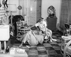 Lucille Ball and Desi Arnaz at home
