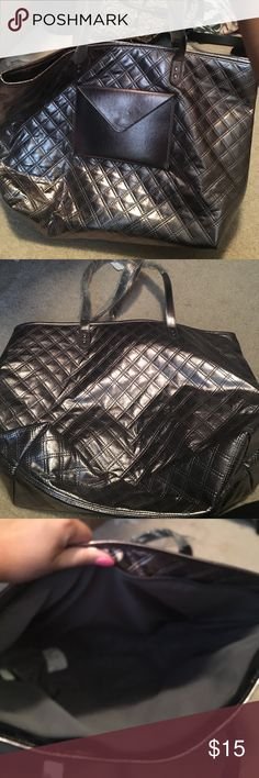 NWT tote metallic silver. NWT tote metallic silver. Zips close with cute envelope pouch in front. Bags Totes