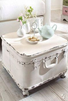 Love this idea. Paint an old suitcase, add feet and you've got a fabulous coffee table that doubles for storage. Start shopping your flea markets for suitcases friends.