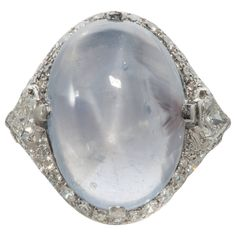 Art Deco Blue-Grey Star Sapphire Diamond Platinum Cocktail Ring | From a unique collection of vintage cocktail rings at https://www.1stdibs.com/jewelry/rings/cocktail-rings/