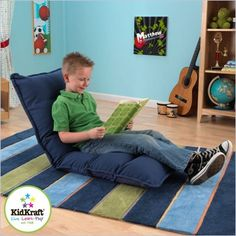 Adjustable Lounger in Denim. Use it as a reclined seat, lay it flat, or prop up a book for reading.