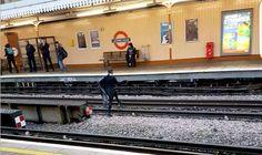 Terrifying moment schoolgirl jumps over LIVE Tube line in shocking image - Express.co.uk