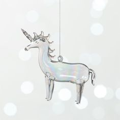 Shop Handblown Glass Unicorn Ornament.   Crafted from delicate handblown glass, these whimsical creatures add extra holiday magic to any tree.  Handblown Glass Ornaments are a CB2 exclusive.