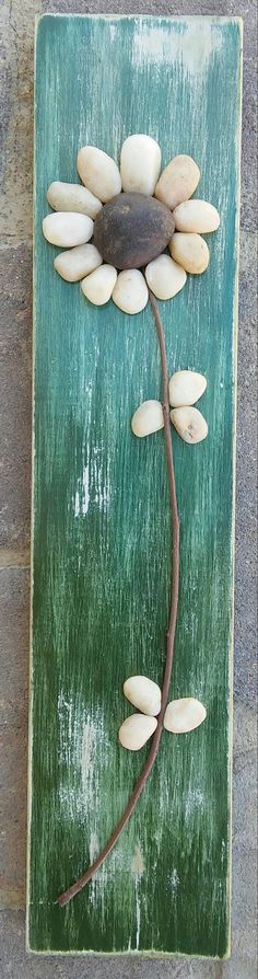 Pebble Art depicting a pretty flower (all natural materials including reclaimed wood, pebbles, twigs) 15 1/2 x 3 1/2