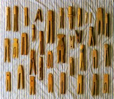 ∷ Variations on a Theme ∷ Collection of old wooden clothespins