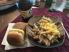 Simple Dinner tonight  Chicken and Mushroom Casserole  Whole Wheat Pasta  Whole Wheat garlic bread  And a Coors to wash it down!