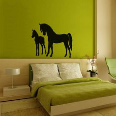 Give any space a touch of Western charm with our sweet Standing Mare and Foal Wall Decal. This lovely decal features an adult mare standing next to a younger, smaller horse. Thanks to its sleek silhouette design and fine attention to detail, this decal will add a warm, personal atmosphere to any wall space.