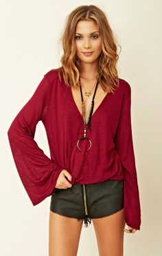 Edgy boho outfit - oxblood 70s style flared sleeve top paired with a leather mini with cute zip detail.