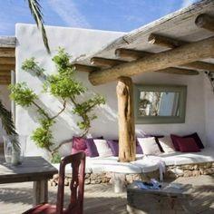 Een tuin met het Ibiza lounge gevoel. Kan ook best in Nederland.