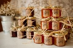 Raffia-tied jars of apricot & amaretto jam for the women and orange marmalade & whiskey for the men