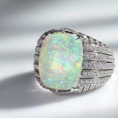 Kat Florence - Welo opal ring with diamonds