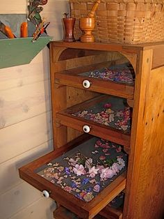 Old drying rack holds edible flowers which are then transferred to clear glass storage containers for use topping salads, cakes,. Herb Drying Racks, Drying Herbs, Glass Storage Containers, Design Jardin, Garden Design, Herb Garden, Fruit Garden, Garden Pests, Edible Flowers
