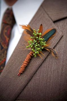 groom boutonnieres with feathers