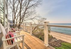 This refined beachfront retreat was designed by Mike Schaap Builders along with Benchmark Design Studio, located in Michigan City, Indiana. Deck Stairs, Deck Railings, Cable Railing, Railing Ideas, Hale Navy, Lake Michigan, Patio Renovation Ideas, Ipe Decking, Beach Patio