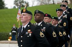 "Special Forces Green Beret soldiers from each of the Army's seven Special Forces Groups stand silent watch during the wreath-laying ceremony at the grave of President John F. Kennedy, Nov. 17, 2011 Image Source: ""Seven Green berets"" by U.S. Army"