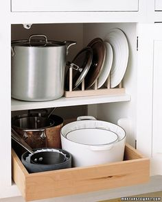 Organizing Pot Lids To eliminate the search for the right lid amid an unwieldy stack each time you use your pots and pans, store them neatly: Place a wooden peg rack in a cupboard, and line up the lids vertically between the pegs. Organisation Hacks, Pot Lid Organization, Lid Organizer, Kitchen Organization, Organizing Solutions, Kitchen Organizers, Organizing Tips, Organising, Kitchen Storage Solutions