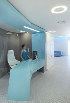 Free form reception desk. Embryocare Clinic Displaying New Direction In Healthcare Design #ClinicExteriorDesign