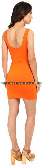 Add some class to your everyday look with the Yara Dress. ; Sheath silhouette. ; Tangerine print allover a viscose-blend fabrication. ; Deep scoop neckline. ; Fixed shoulder straps. ; Flirty cutout and tie detail at left side. ; Straight hemline. ; Slip-on. ; 95% viscose, 5% spandex. ; Hand wash cold, dry flat. ; Made in the U.S.A. and Imported. Measurements: ; Length: 36 in ; Product measurements were taken using size SM. Please note that measurements may vary by size. #Clayton #Dress..