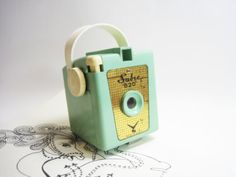 antique camera in my favorite minty green.  Maybe as a center piece or decorative item near the sign-in area?