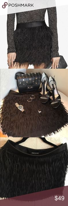 JUST IN❗️Express Fringe Skirt EUC Black Express Fringe Mini Skirt Side Zipper Skirt w 2 Eye-hook Closure. Fully Lined. 100% Polyester. Great party skirt! Pair with strappy heels or gladiator flats for a more casual look. Please ask any questions prior to purchase to ensure proper fit. I'm happy to answer any you may have. Express Skirts Mini